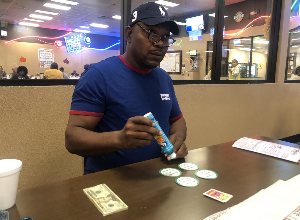 Victor Igbinedion plays a game of 4 by 4 bingo with his dauber in hand.