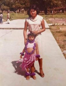 Elizabeth Villanueva stands with her kindergarten teacher.